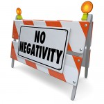 No Negativity words on a road construction barrier or sign to illustrate that only positive attitudes, good moods and outlooks are allowed