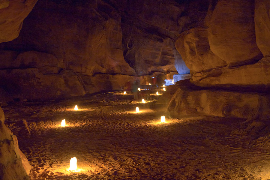 narrow gorge The Siq in Petra at nignt, Jordan